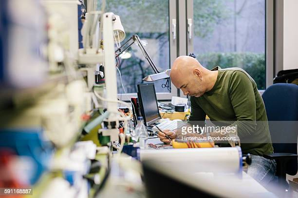 engineer working on conductor board - healthcare stock pictures, royalty-free photos & images