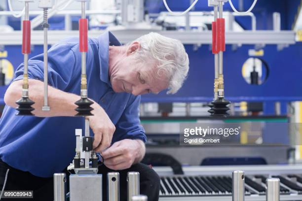 engineer working on electrical component controls in engineering plant - sigrid gombert stock pictures, royalty-free photos & images