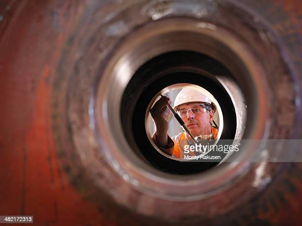 Engineer working on excavator parts in surface coal mine