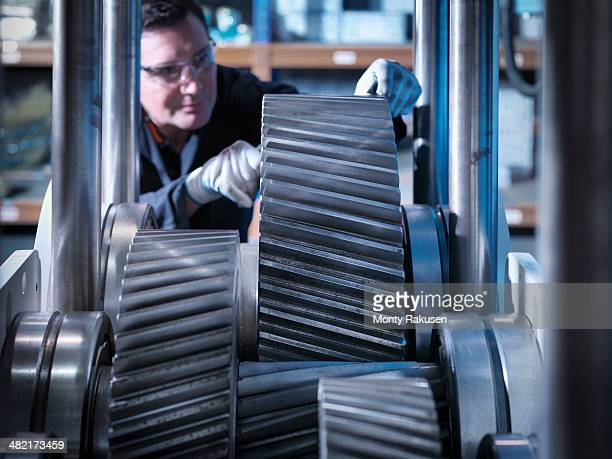 engineer working on industrial gearbox - monty rakusen stock pictures, royalty-free photos & images