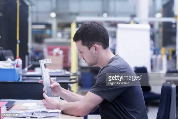 engineer working on metal rail in engineering plant - sigrid gombert stock-fotos und bilder