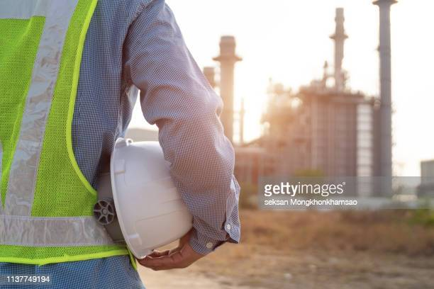engineer working on power plant with safety helmet - power occupation stock pictures, royalty-free photos & images