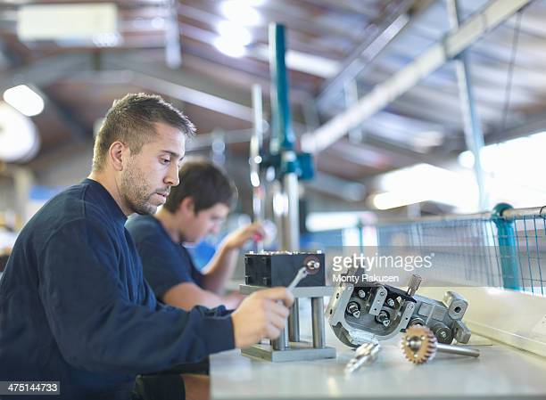 Engineer working on production line in factory