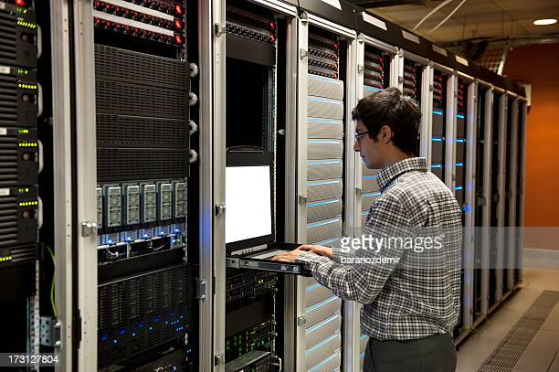 IT engineer working on server in data center