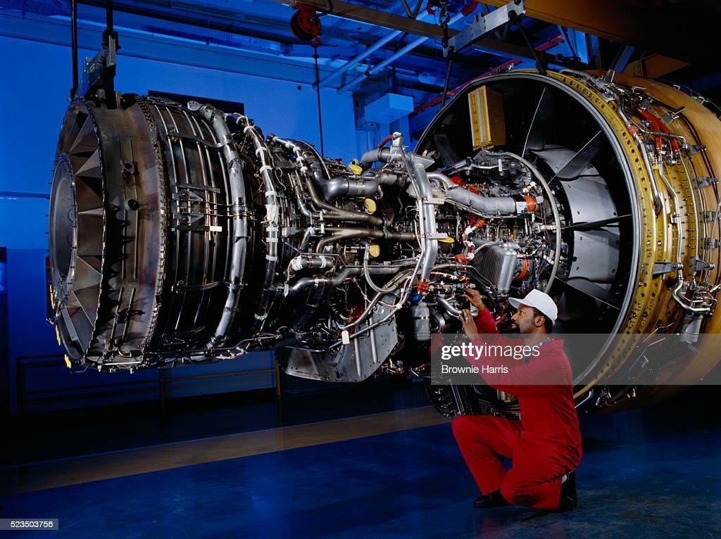 Engineer Working On Turbofan Jet Engine Stock Photo - Getty