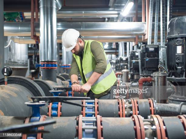 engineer working on valve in factory or utility - air duct stock pictures, royalty-free photos & images
