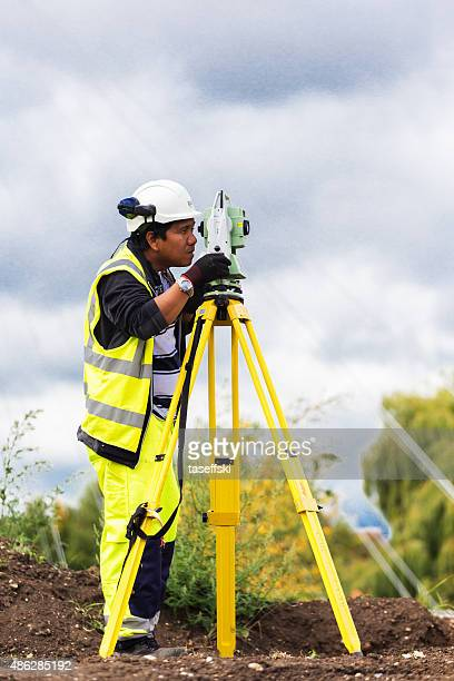 Engineer working with a modern theodolite
