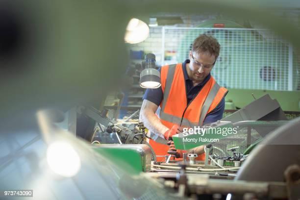 engineer working with machine in engineering factory - monty rakusen stock-fotos und bilder