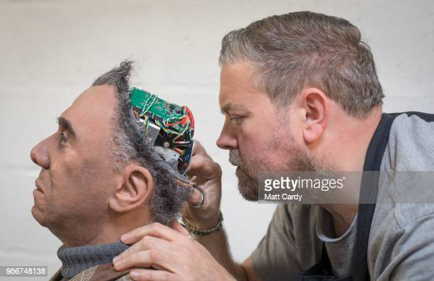 Engineered Arts prosthetic expert Mike Humphrey checks on Fred a recently completed Mesmer robot that was built at the company's headquarters in...