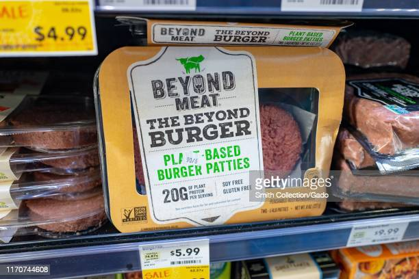 Engineered plantbased burger patties from food company Beyond Meat are visible on shelves among other meat alternatives at a grocery store in San...