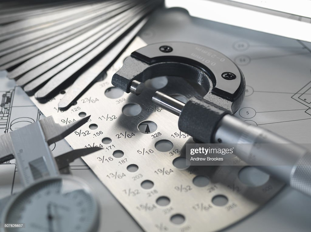 Engineering design micrometer feeler gauge and screw gauge on engineering design micrometer feeler gauge and screw gauge on blueprint stock photo malvernweather Image collections