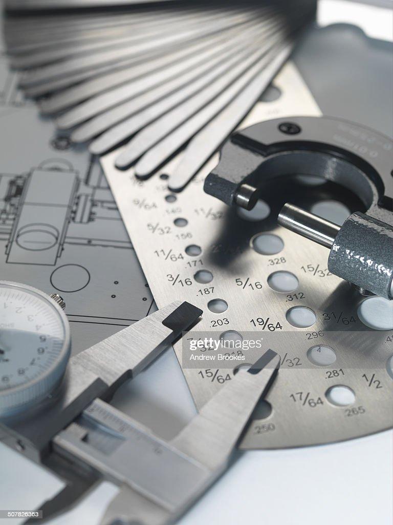 Engineering design micrometer screw gauge and feeler gauge on engineering design micrometer screw gauge and feeler gauge on blueprint stock photo malvernweather Choice Image