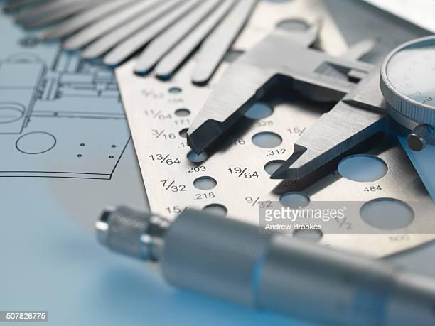 Engineering design - screw gauge, feeler gauge and micrometer on blueprint