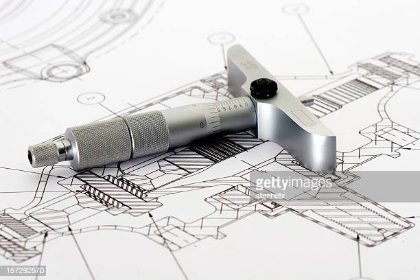 Engineering drawing with tool resting on paper