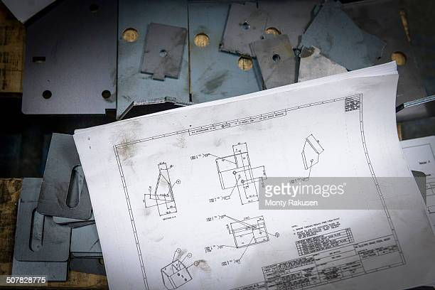 Engineering drawings and parts in sheet metal factory
