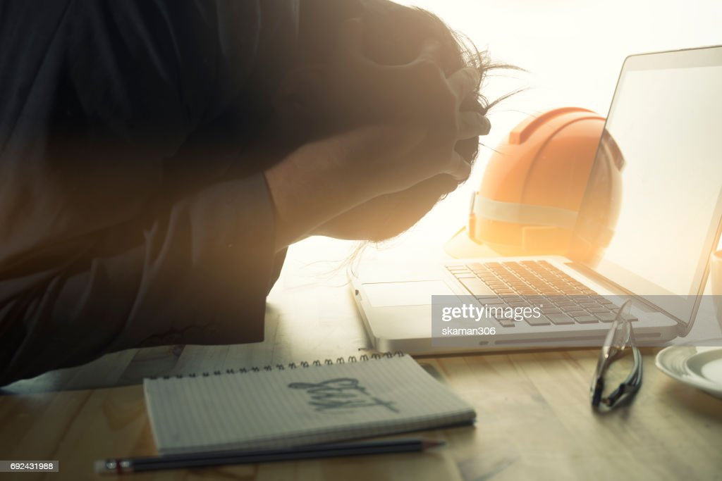 Engineering exhausted after finish homework with laptop and smart-phone and table : Stock Photo