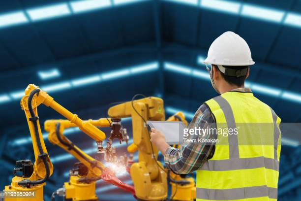 engineering is planning to install robot welding machines - industrial equipment stock pictures, royalty-free photos & images