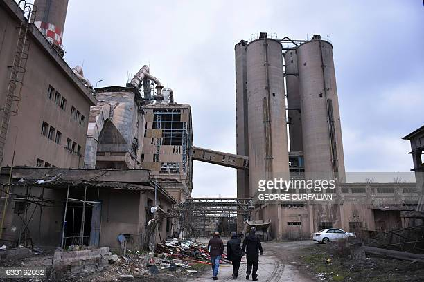 Engineering specialists tour a cement factory Aleppo's Sheikh Saeed district on January 31 2017 as they analyse to fix the damage in order to start...