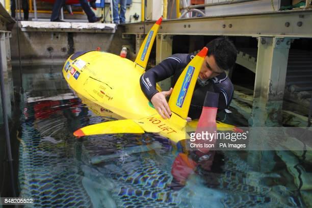 Engineering student Oli Fairfax, from Bath University, readies their human powered submarine, Minerva, before racing at Qinetiq's Ocean Basin test...