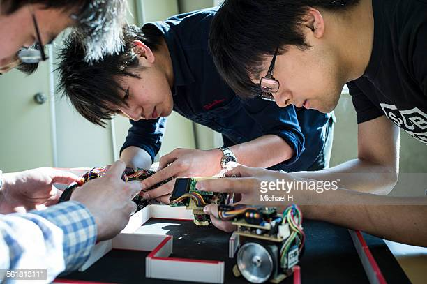 engineering students assembling robotic car