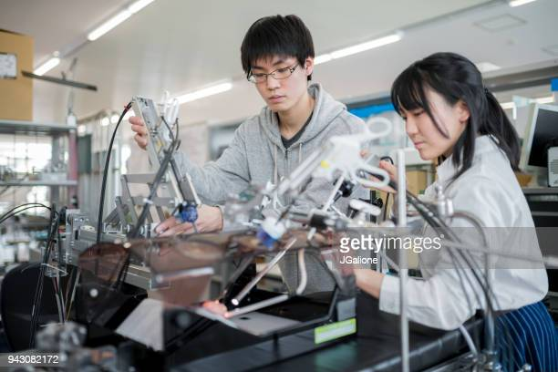 Engineering students working on a medical machine