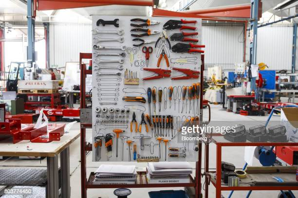 Engineering tools sit on a workstation board during the testing of mobile robots also known as an AGV or automated guided vehicle inside the...