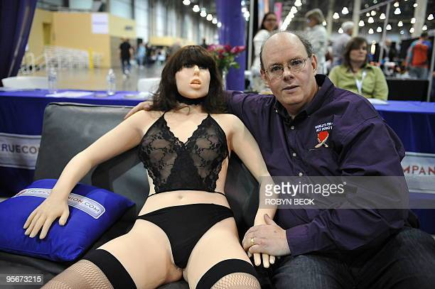 Engineerinventor Douglas Hines poses with his company's 'True Companion' sex robot Roxxxy at the TrueCompanioncom booth at the AVN Adult...