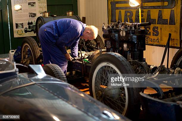 Engineer/mechanic working on engine in Museum at The Double Twelve Motoring Festival Press Day at The Brooklands Museum 26th Feb 2015
