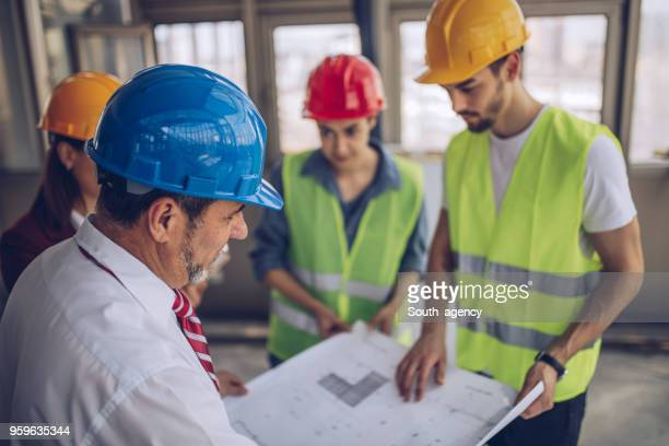 Engineers and architects working on construction site