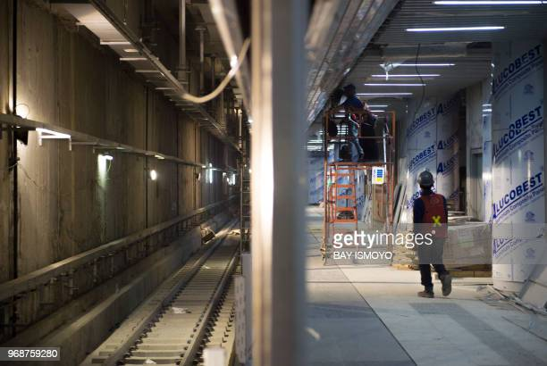 Engineers and workers are seen in the tunnels of Jakarta's MRT construction project in Jakarta on June 7 2018 Deep below Jakarta's trafficchoked...