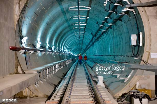TOPSHOT Engineers and workers are seen in the tunnels of Jakarta's MRT construction project in Jakarta on June 7 2018 Deep below Jakarta's...