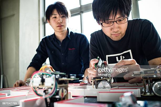engineers assembling robotic car