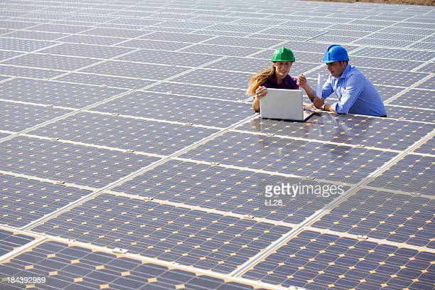 Engineers at a solar farm