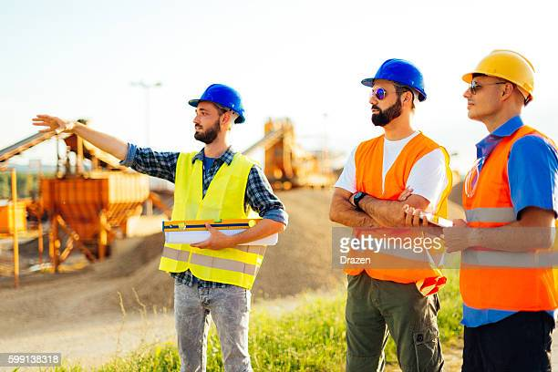 Engineers at construction discussing future investments