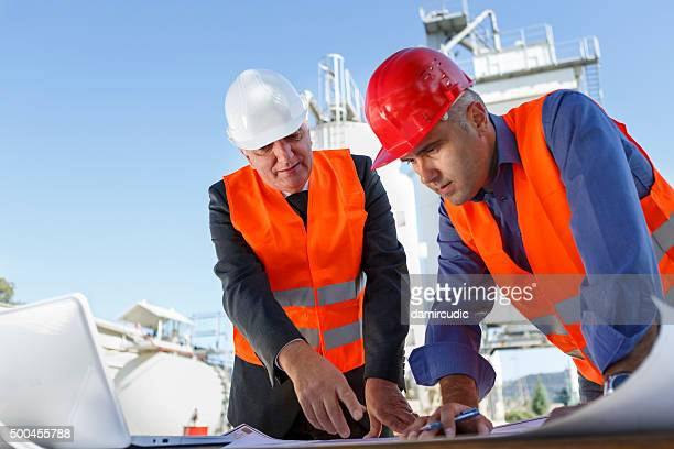 engineers at industrial facility - gas refinery stock photos and pictures