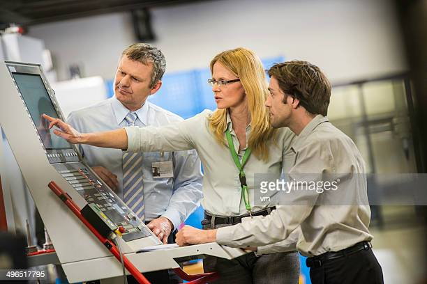 Engineers At The Manufacturing Plant