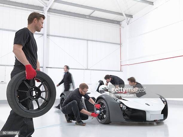 Engineers attend supercar in sports car factory