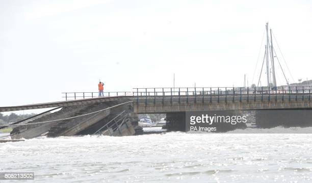 Engineers attend the collapsed railway viaduct across the Malahide estuary south of DublinPicture date Saturday August 22 2009 Keith Farrelly driving...