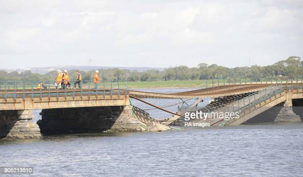 Engineers attend the collapsed railway viaduct across the Malahide estuary south of Dublin