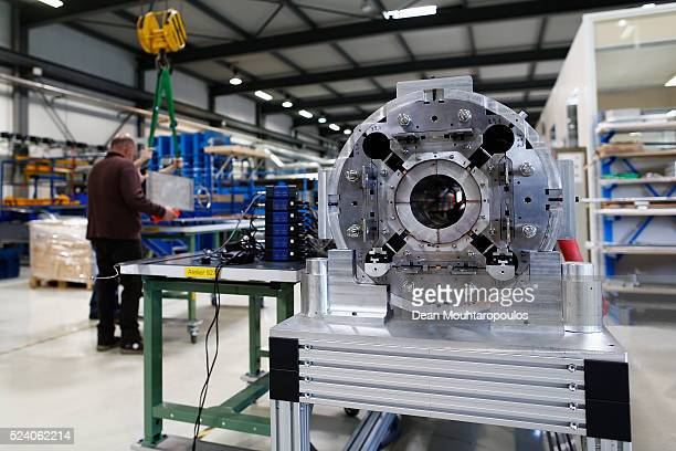 Engineers Bertrand Fornes and Dominique Cote lift a superconducting coil in New Technologies for Future Magnets Building 927 at The European...