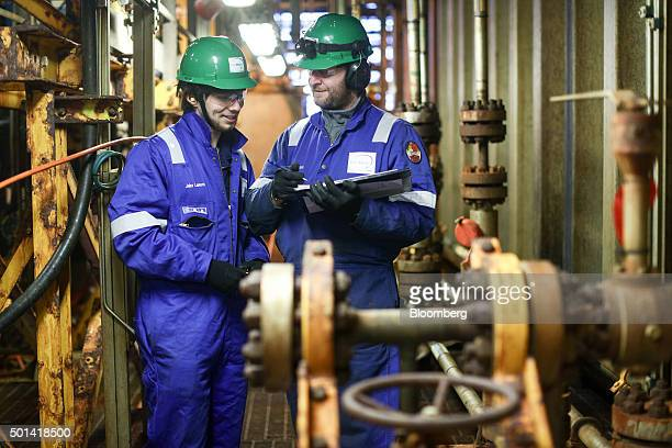 Engineers check the valves on pipes on the towel deck of the Armada gas condensate platform operated by BG Group Plc in the North Sea off the coast...