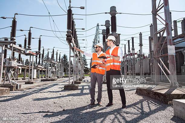 Engineers checking electricity substation