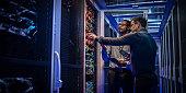 IT engineers checking servers in server room
