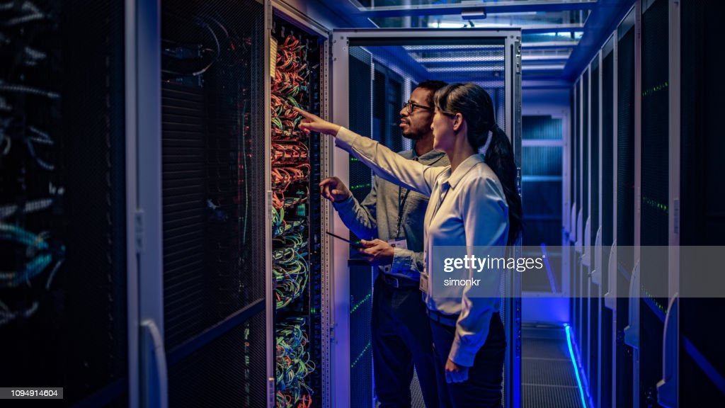 IT engineers checking servers in server room : Stock Photo