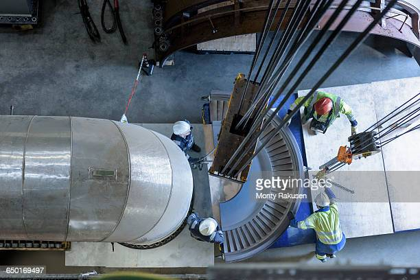 engineers crane steam turbine parts during outage in gas-fired power station - turbine stock photos and pictures