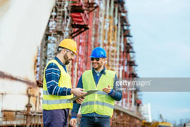 Engineers discussing successful project accomplishment