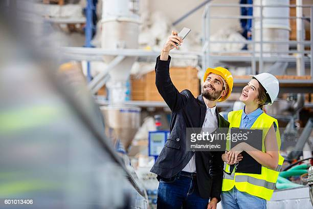 Engineers doing selfie in a factory