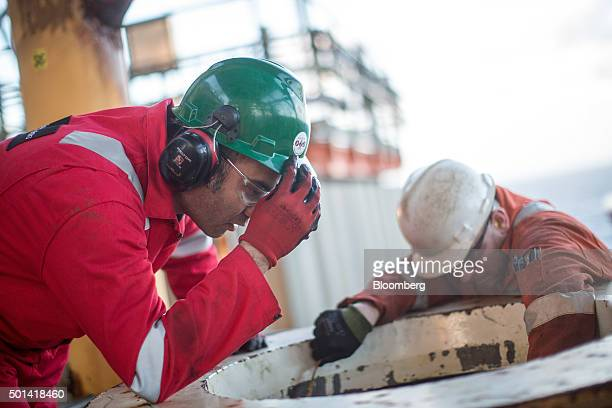 Engineers fix a pig launcher on the Armada platform operated by BG Group Plc in the North Sea UK on the Armada gas condensate platform operated by BG...
