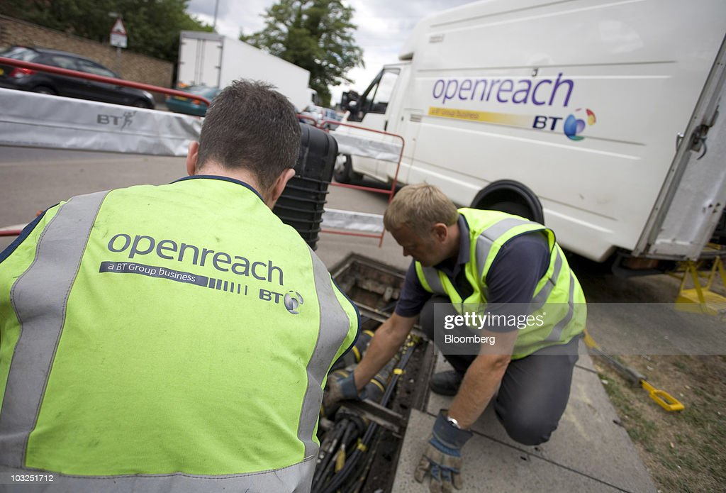 Engineers for BT Openreach, part of the BT Group Plc, remove a fibre optic node for maintenance in Enfield, U.K., on Thursday, Aug. 5, 2010. BT Group Plc, the U.K.'s largest fixed-line phone company, said first-quarter operating profit climbed 5.5 percent helped by job cuts. Photographer: Chris Ratcliffe/Bloomberg via Getty Images