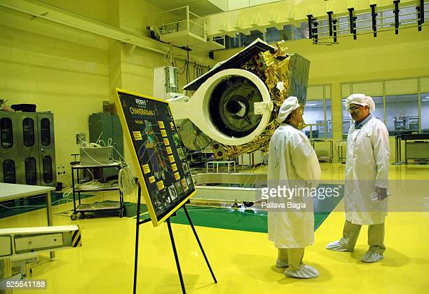 Engineers from ISRO are fussing over lastminute checks of the Chandrayaan1 satellite before it is sent to be placed atop a moonbound rocket at the...